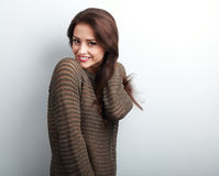 Romantic young beautiful woman holding hair in warm sweater Stock Photo