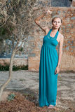 Romantic young blond woman near olive tree Stock Photo