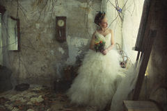 Romantic young bride in vintage interior Stock Images