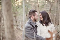 Romantic young couple alone in the forest on a cold winter day royalty free stock photography