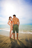 Romantic young couple by the beach Stock Image