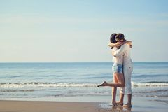 Romantic young couple on the beach kissing. Stock Photo