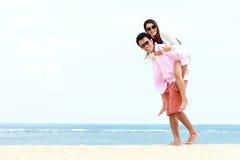 Romantic young couple on the beach Stock Photos