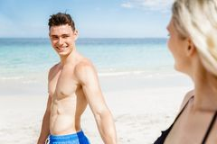 Romantic young couple on the beach Stock Images
