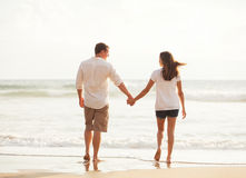 Romantic Young Couple on the Beach at Sunset Royalty Free Stock Photography