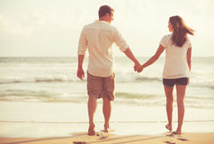 Romantic Young Couple on the Beach at Sunset Stock Image