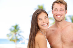 Romantic young couple on beach vacation Stock Images