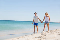 Romantic young couple on the beach Stock Photo