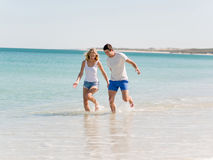Romantic young couple on the beach Stock Image