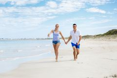 Romantic young couple on the beach stock photography
