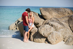 Romantic Young Couple By Rocks At Beach Royalty Free Stock Photography