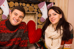 Romantic young couple celebrating Christmas Royalty Free Stock Images