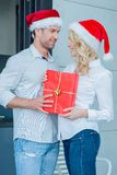 Romantic young couple celebrating Christmas Stock Images