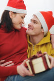 Romantic young couple with Christmas present box Royalty Free Stock Photo