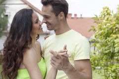 Romantic young couple dancing in park Stock Photography