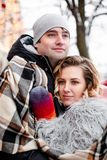Romantic young couple dating in winter, they are hugs each other, she is leaning on her boyfriend`s shoulder royalty free stock images