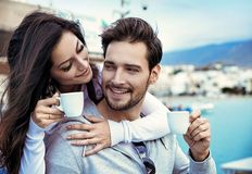 Romantic couple drinking a mornig cup of coffee. Romantic, young couple drinking a mornig cup of coffee Royalty Free Stock Images