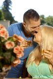 Romantic young couple with drinks kissing Royalty Free Stock Image