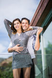 Romantic young couple embracing in balcony Royalty Free Stock Photography