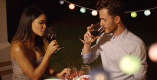 Romantic young couple enjoying dinner and wine Royalty Free Stock Photo