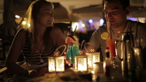 Romantic young couple enjoying drinks in a date stock footage