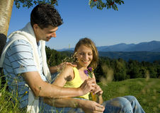 Romantic young couple in field Stock Photos