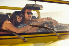 Romantic young couple going on a long drive Stock Photos