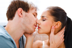 Romantic young couple having kiss Stock Images
