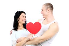 Romantic young couple with heart symbol standing Stock Photography
