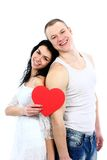 Romantic young couple with heart symbol standing Royalty Free Stock Photo