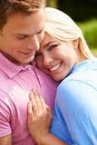 Romantic Young Couple Hugging In Garden Stock Photography