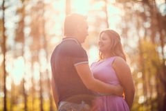 Romantic young couple kissing on background summer forest. Romantic young couple kissing  on background summer forest Royalty Free Stock Photos