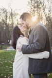 Romantic young couple kissing outside on a cold fall day stock photography