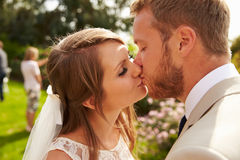 Romantic Young Couple Kissing On Wedding Day Stock Image