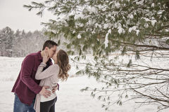 Romantic young couple kissing in winter Royalty Free Stock Photography