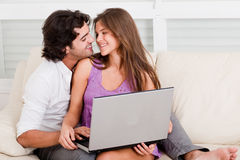 Romantic young couple with laptop Stock Images