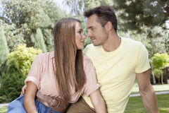 Romantic young couple looking at each other in park Stock Photo