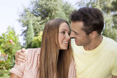 Romantic young couple looking at each other in park Royalty Free Stock Photography