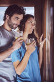 Romantic young couple looking at window Stock Image