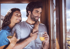 Romantic young couple looking at window Stock Images