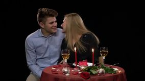 Romantic young couple in love on a date sitting in stock video footage