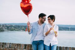 Romantic young couple dating outdoor and blowing bubbles Royalty Free Stock Images