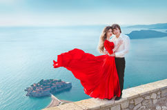 Romantic young couple in love over blue sea shore background. Fa Royalty Free Stock Photos