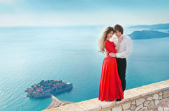 Romantic young couple in love over sea shore background. Fashion Royalty Free Stock Photo