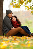 Romantic young couple in love relaxing outdoors. Romentic young couple in love relaxing outdoors in park stock photography