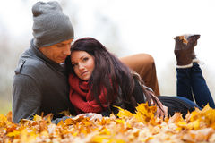 Romantic young couple in love relaxing outdoors. Romentic young couple in love relaxing outdoors in park stock photos