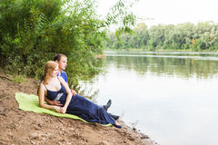 Romantic young couple in love relaxing outdoors in park Stock Photos
