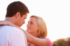 Romantic Young couple in love at sunset Stock Image