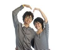 Romantic young couple making heart shape with arms. Isolated on white background Royalty Free Stock Image