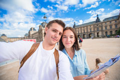 Romantic young couple with map of city taking Royalty Free Stock Image